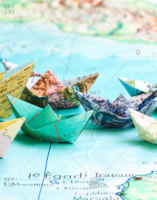 Paper Boats Folded Out Of Maps Stock Photo Offset