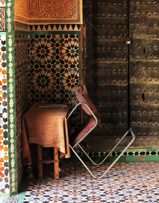 Colorful hallway with a chair leaned on a table