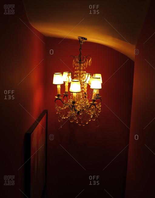 Chandelier illuminating red corridor