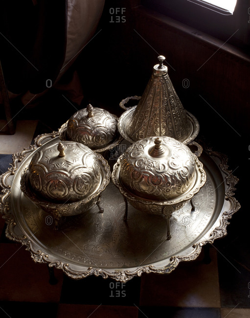 Patterned silver pots on a tray