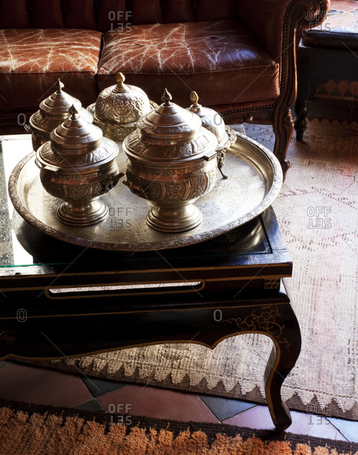 Collection of silver pots on a table