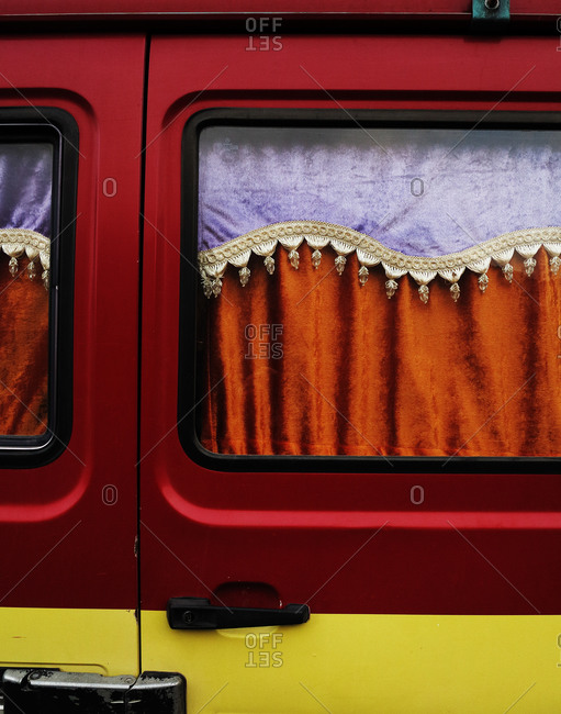 Close-up of a van's curtained window