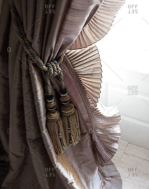 Close-up of a curtain tied with rope