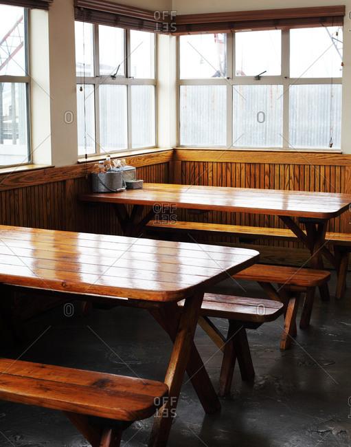 Picnic tables set up inside