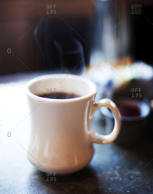 A cup of steaming coffee