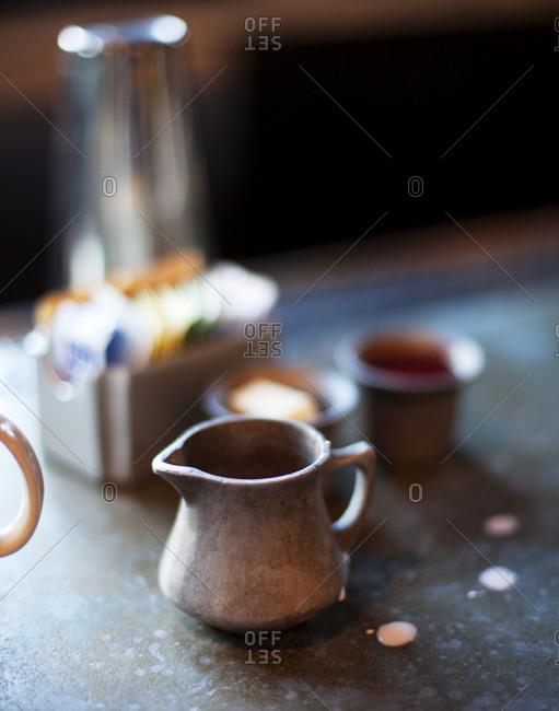 A creamer on a table
