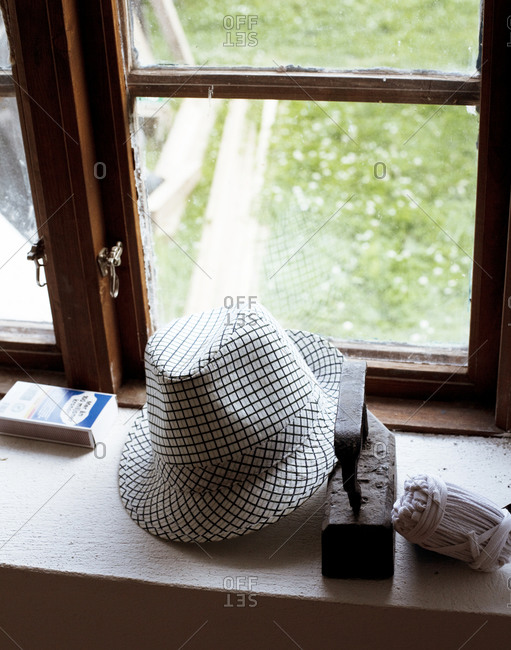 Hat and weight on windowsill