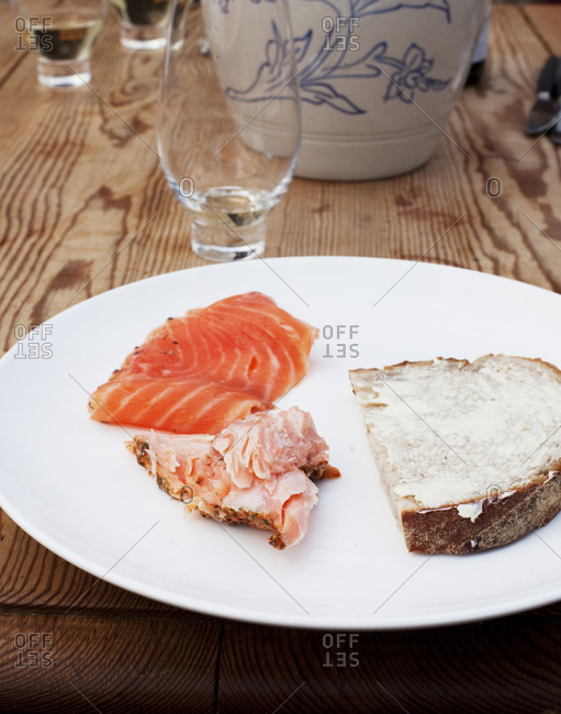 Two pieces of salmon with bread