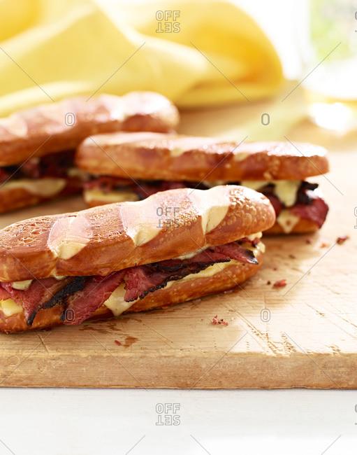 Swiss pretzel pastrami sandwich