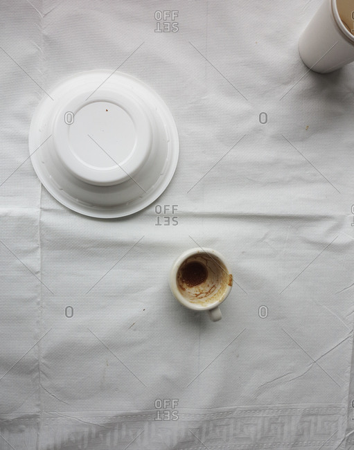 Disposable dishes and one glass cup