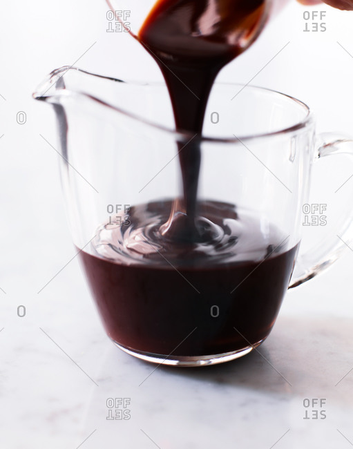 Pouring melted chocolate in preparation for baking