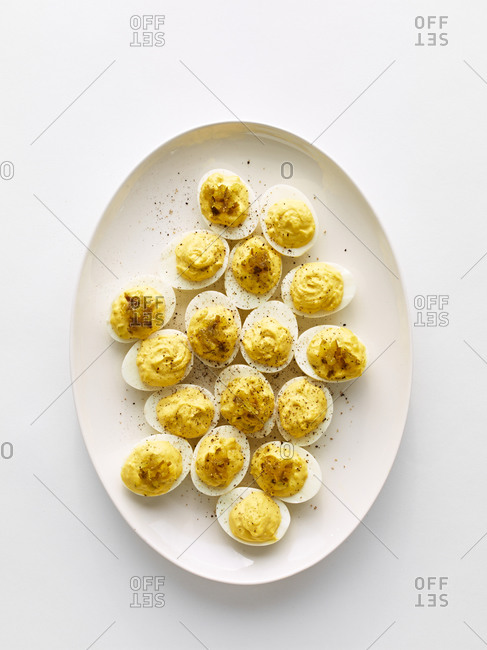 Deviled eggs sprinkled with ground pepper