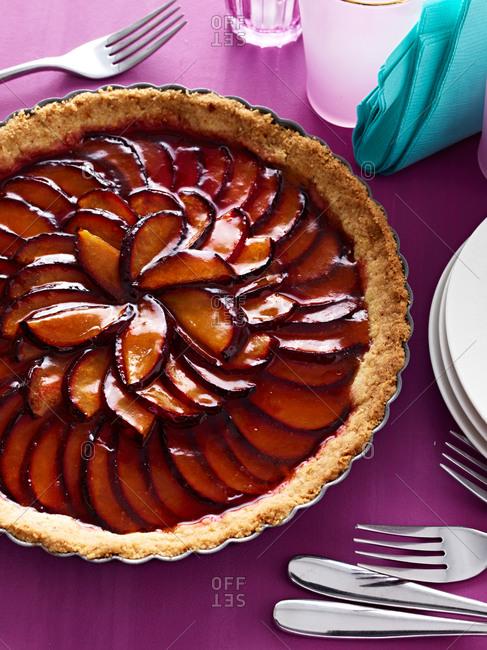 A whole, freshly baked peach pie