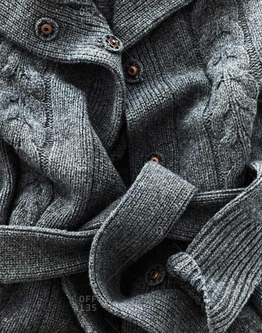 A detail of a gray sweater