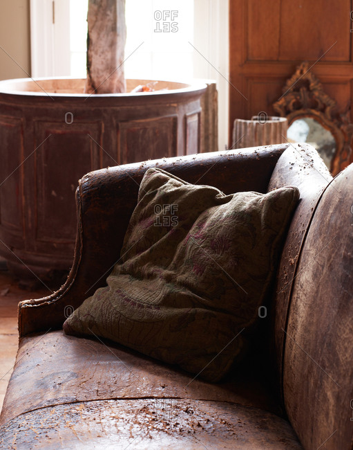 Vintage leather couch and textile pillow