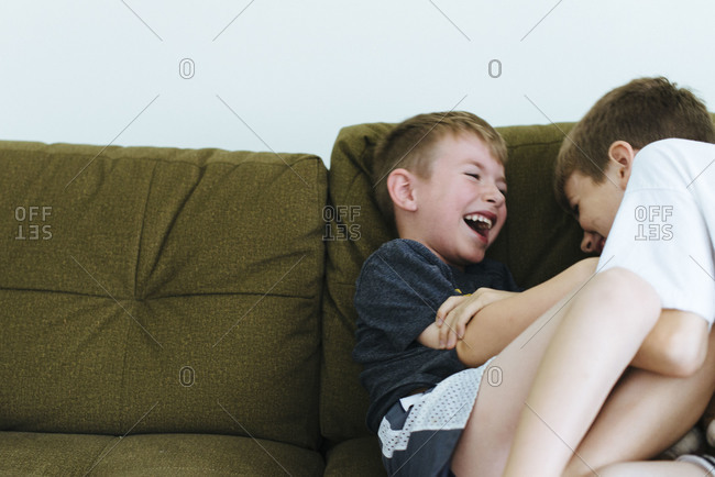 Two boys tickleling each other