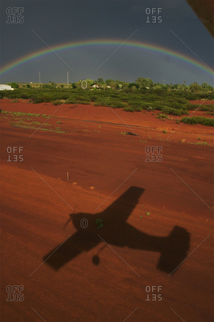 A rainbow and shadow of an airplane in Halls Creek.