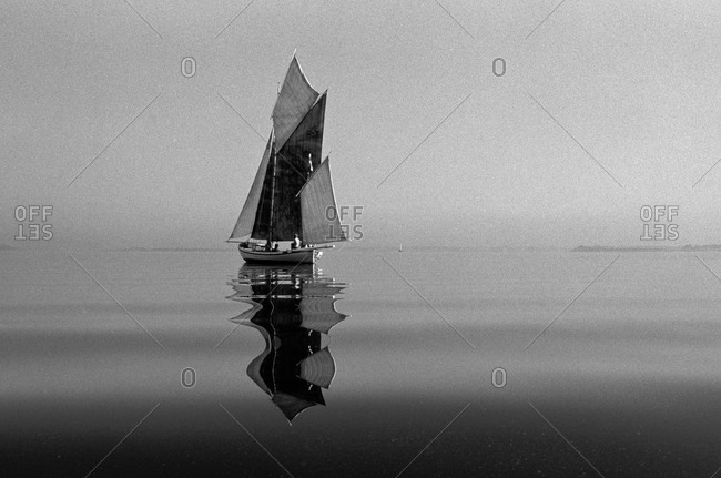 Roskilde, Denmark- A wooden sailing ship in the fjord, reflection