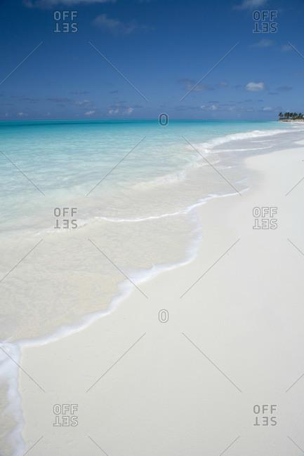 Waves rolling onto sand beach, Grace Bay