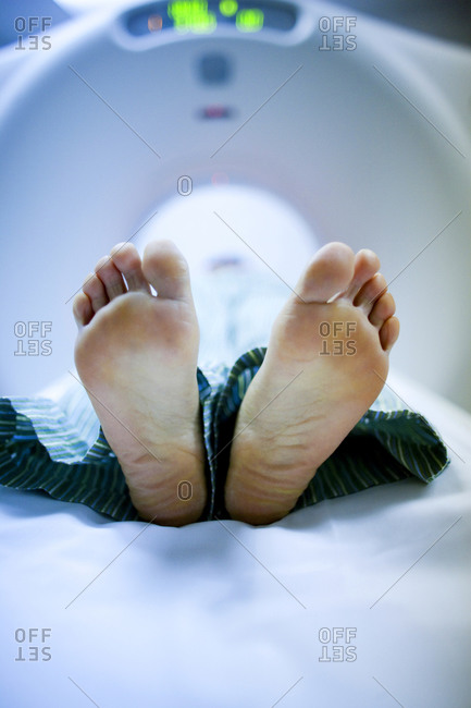 Closeup of woman's feet on diagnostic bed