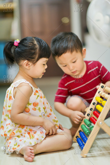 Children learn to count with a colorful abacus