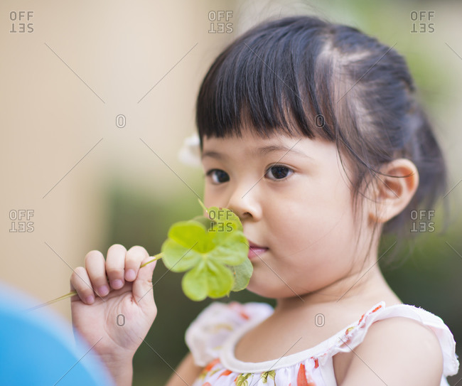Portrait of a girl smelling leaves