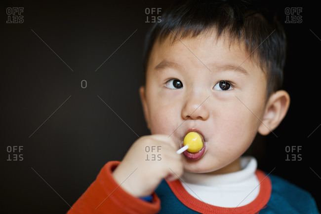 Little boy eating lollipop