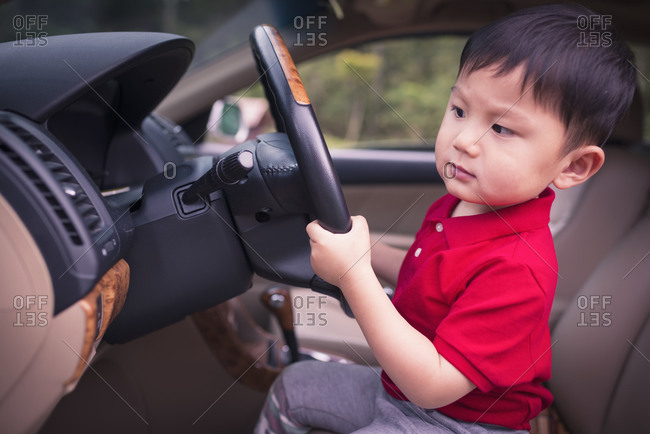 Little boy driving car