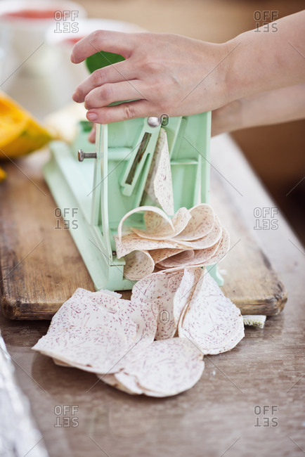 Close up of woman slicing sweet potato
