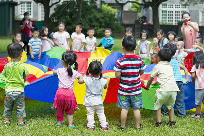 Children learn teamwork on lawn