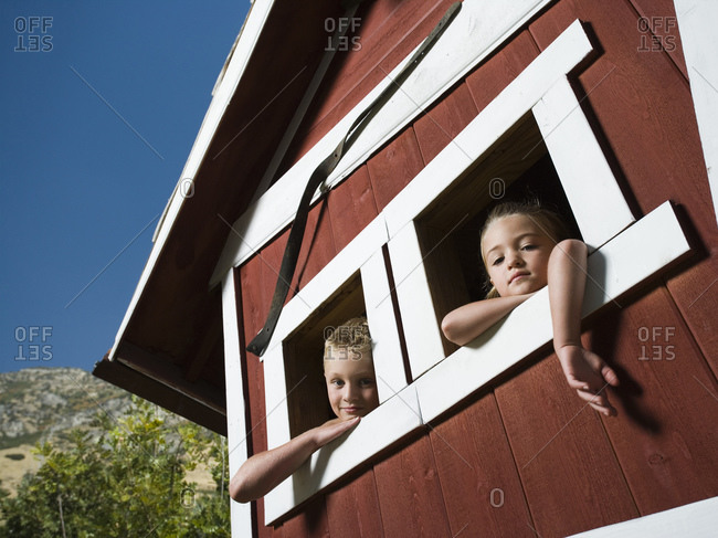 Boy and girl in a playhouse