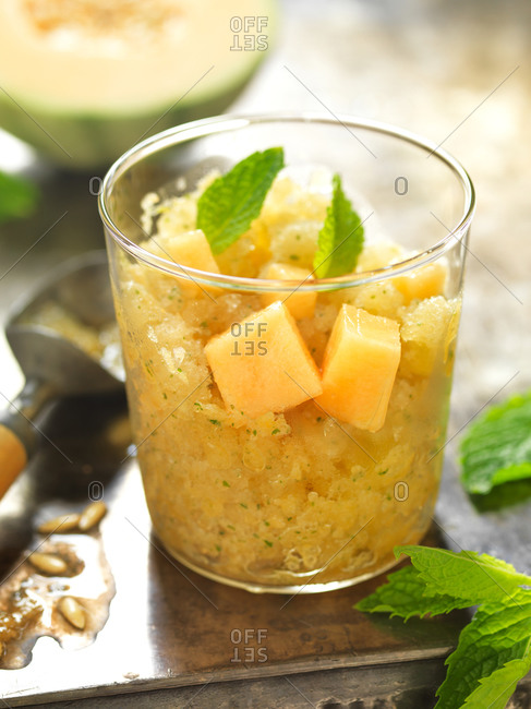 Refreshing melon granita with mint leaves
