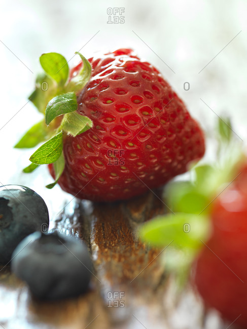 Close-up of raw blueberries and strawberries