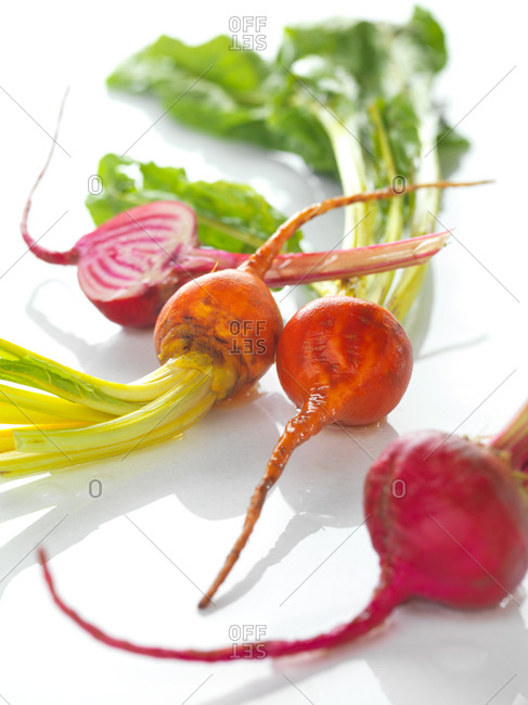 Yellow and red beetroot on white surface