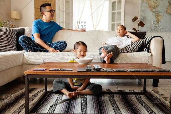 Father and his children relaxing in the living room