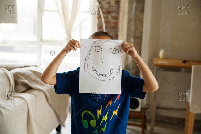 Child showing a drawing