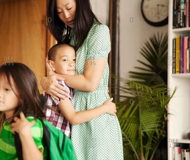 Mother hugging her son - Offset