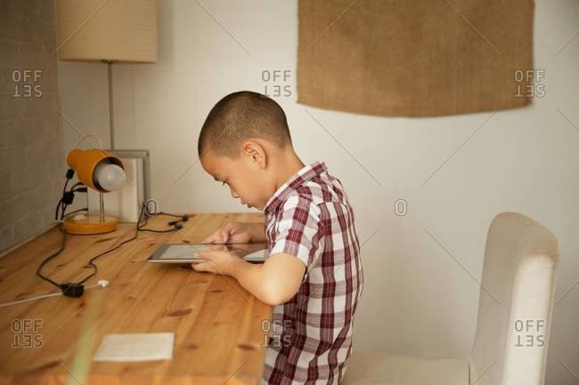Boy playing with tablet computer