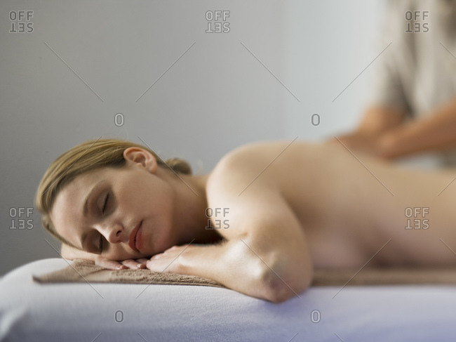 Woman giving other woman back massage