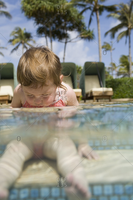 Girl sitting in outdoor pool