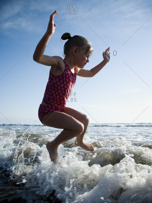 Young girl jumping in water
