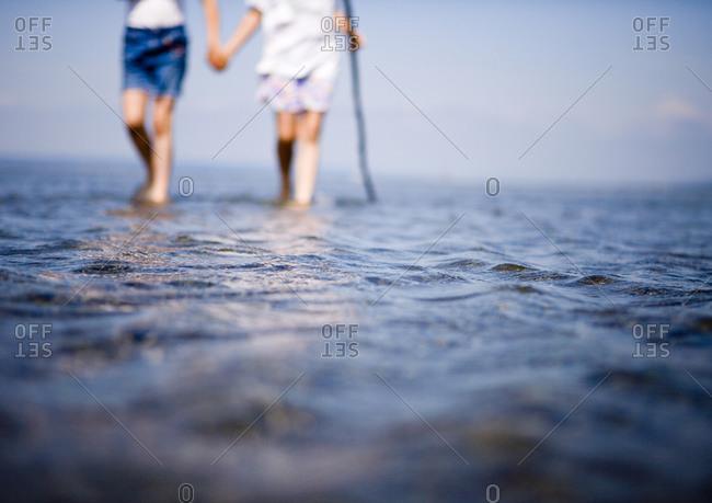 Two female children wading