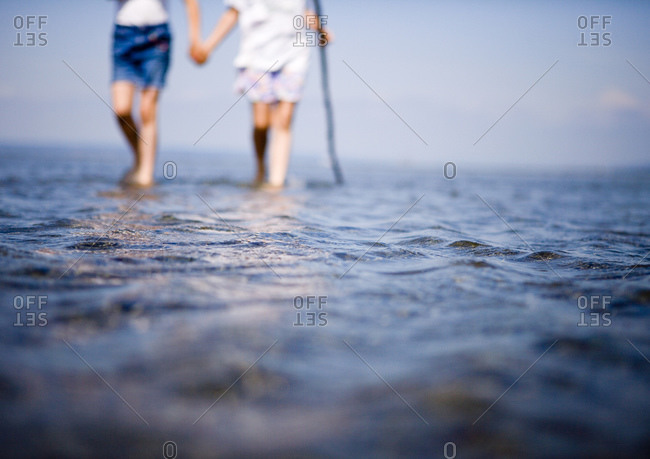 Two female children wading