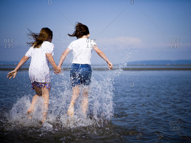 Two female children splashing in the water together