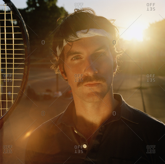 Portrait of man with tennis gear