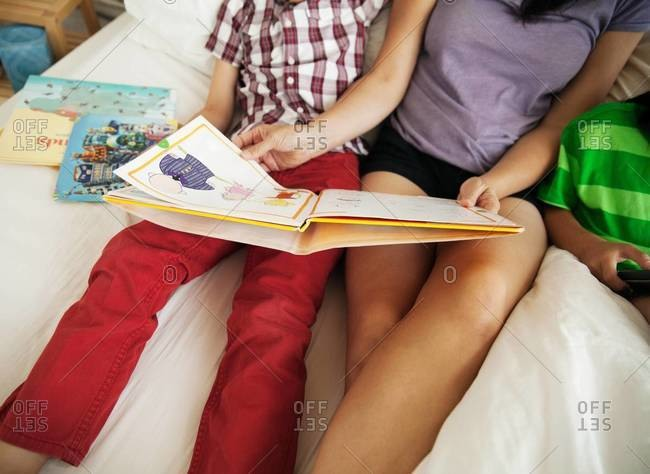 Mother and son reading in bed