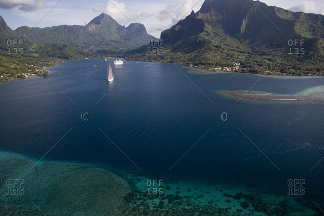 Aerial photo taken from an ultralight airplane, of Cook's Bay, Moorea, showing cruise ships at anchor