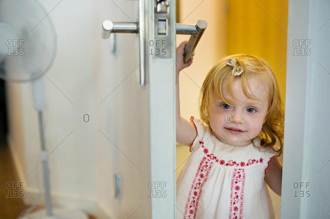 Little girl opening the door