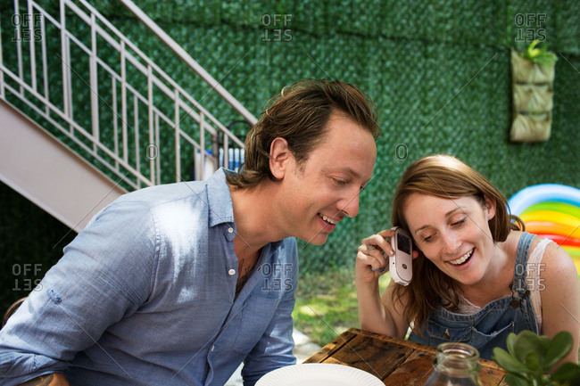 Woman and man talking on a mobile phone