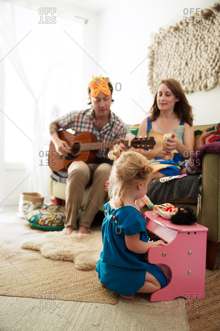 Family playing music in living room